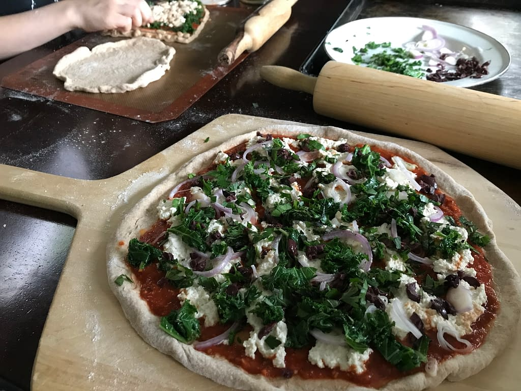 pizzas being assembled