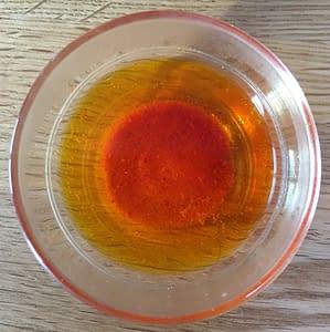 ground saffron soaking in water
