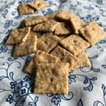 sourdough crackers on a white napkin with blue flowers