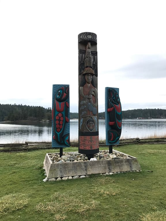 totem pole and Indian carvings of salmon overlook the bay... reminding us of who was really here first.