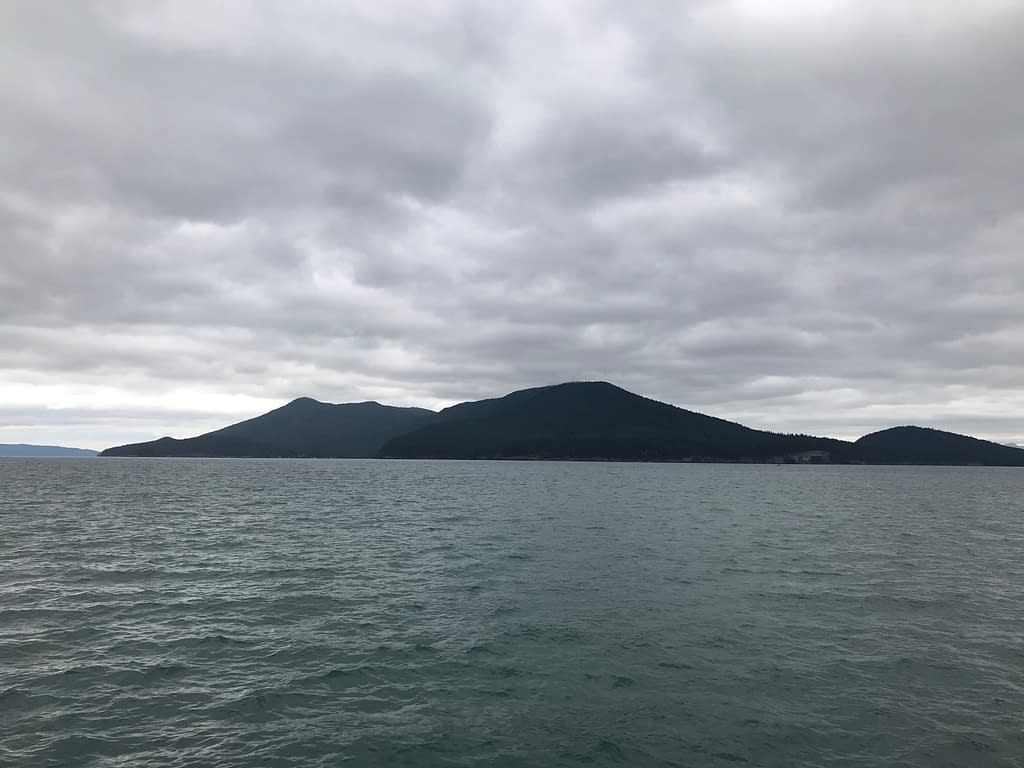 dark islands rising from the flat grey waters