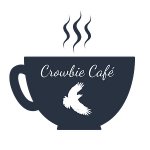 """a dark mug with a white crow silhouette that reads """"Crowbie Cafe"""" with three wiggly lines of steam floating from the top"""